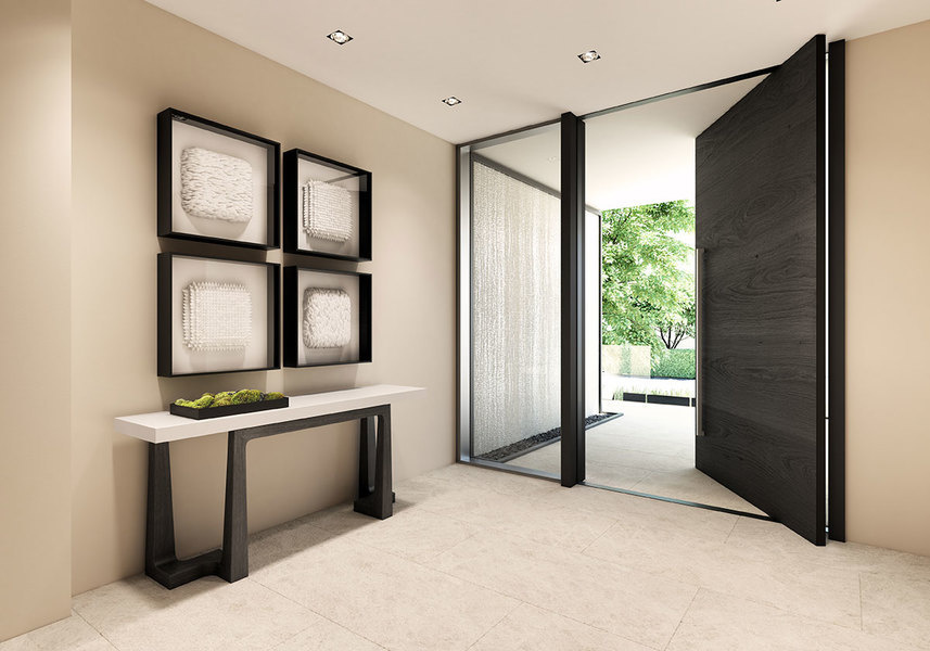 A streamlined console and bold sculptural elements make the entryway of this Eleven on Lenox Miami to