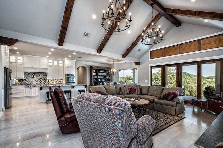 Designed by Jaclyn Galbraith of Robare Custom Homes, this sweeping family room mixes both ease and el