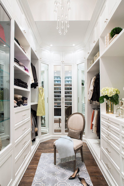This closet designed by Lisa Adams of LA Closet Design maximizes space by using floor-to ceiling shel