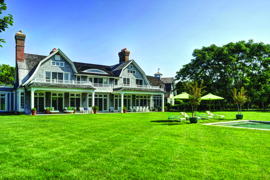 This two-story, 9,000 square-foot Gambrel-style home blends traditional luxury with the chic contempo