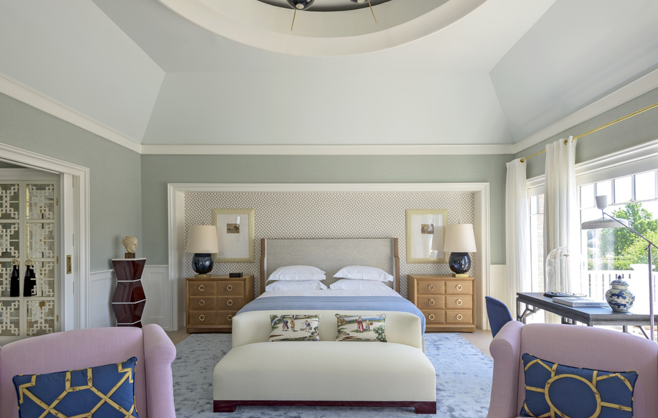 This bedroom designed by Achille Salvagni features a recessed patterned accent wall that adds dimensi