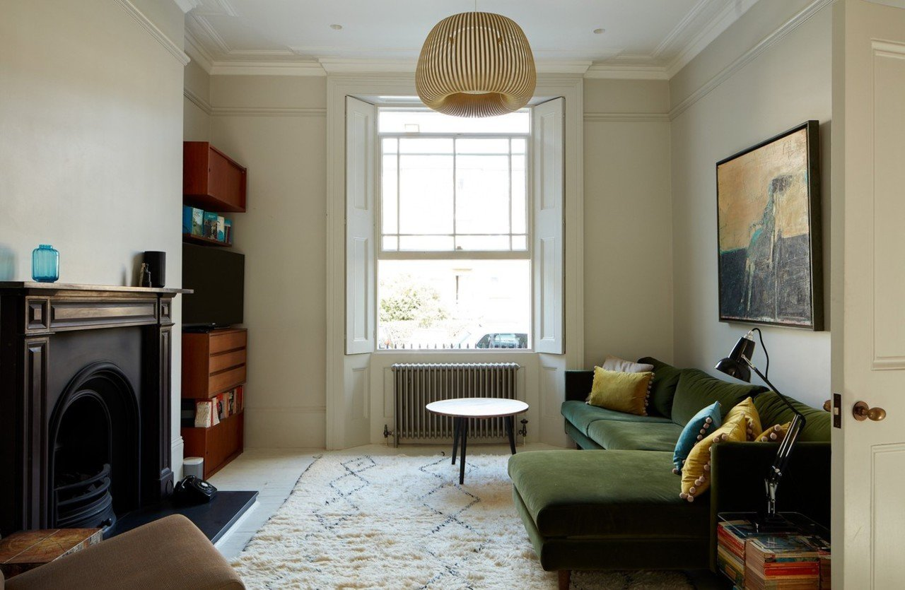 The living room has been accessorized with Midcentury Modern furnishings.